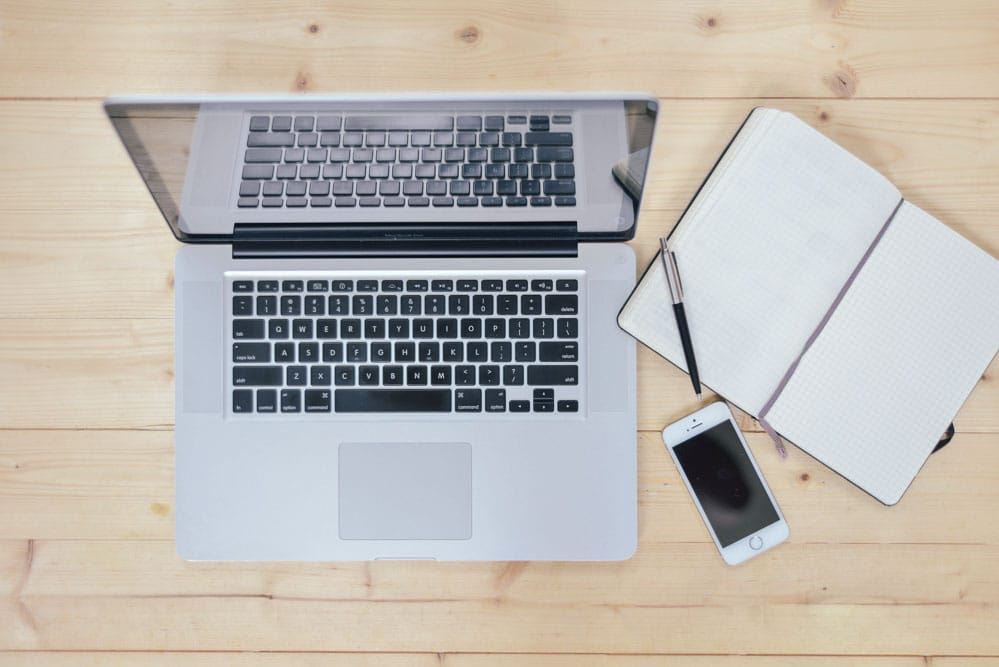 Laptop, Notebook & Smartphone On Wooden Desk