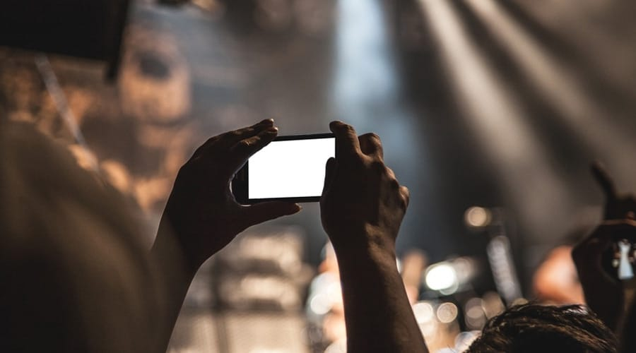 Hands-smartphone-taking-photo-festival