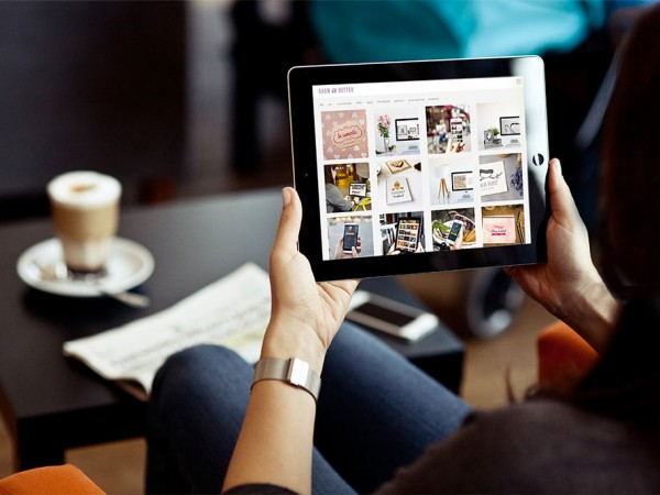 10 Woman looking at iPad Mockup